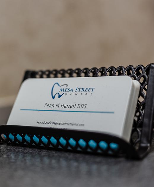 dentist Sean M. Harrell's business cards at Mesa Street Dental in El Paso.