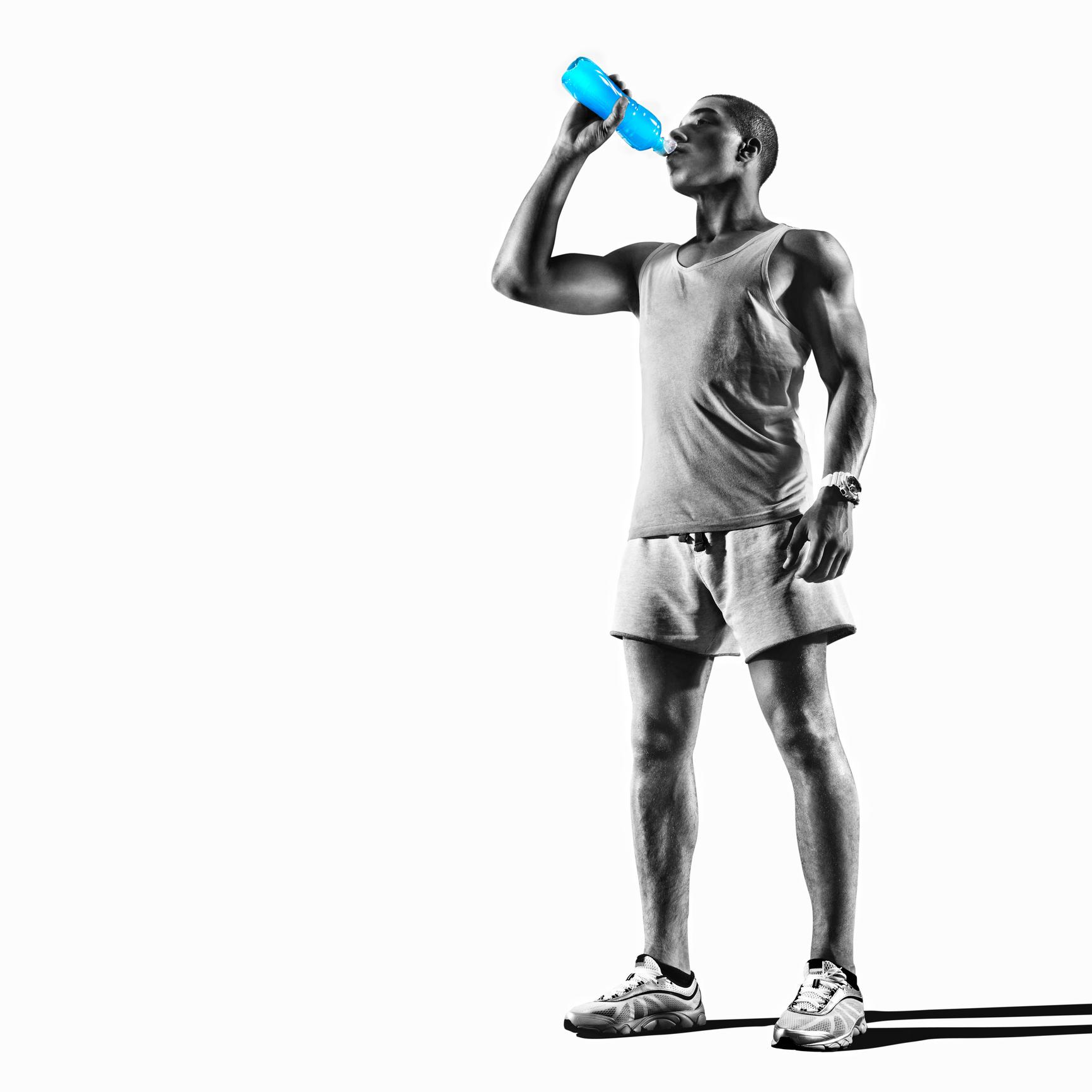 athletic man drinking a blue sports drink