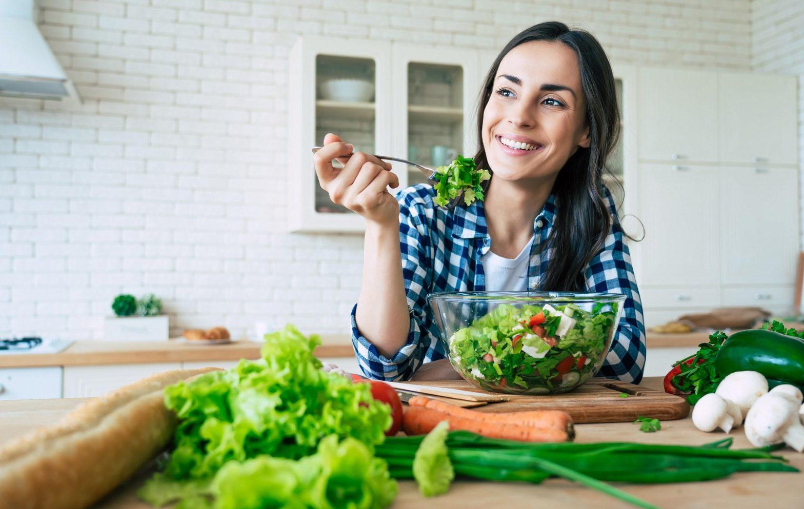 woman eating salad for healthy teeth